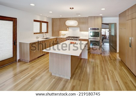 Idaho Falls, ID USA 20 Feb. 2011 An elegant minimalist residential kitchen with modern cabinetry constructed from quarter sawn white oak - stock photo