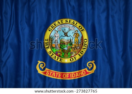Idaho flag pattern with a peace on fabric texture,retro vintage style - stock photo