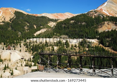 Idarado mine trestle with Red Mountain #2 and #3 in the background, between Ouray and Silverton, CO, USA. The Idarado mine was founded in 1939 to extract lead, copper, zinc ore and closed in 1978.  - stock photo