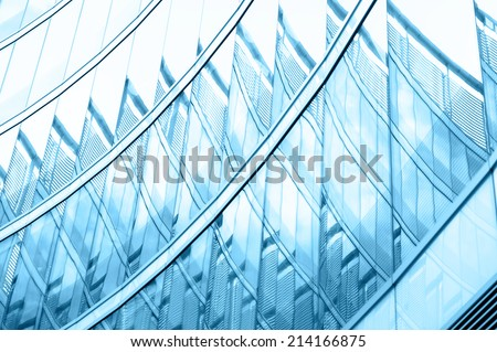 ide angle view to steel blue background of glass high rise building Business concept of successful industrial architecture - stock photo
