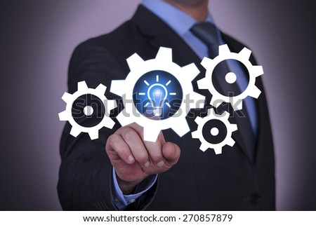 Idea And Gear Touch with Businessman Hand - stock photo
