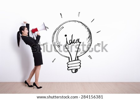 idea and innovation concept - business woman talking in megaphone
