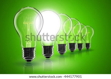 Idea and  leadership concept -  incandescent light bulb on the black background