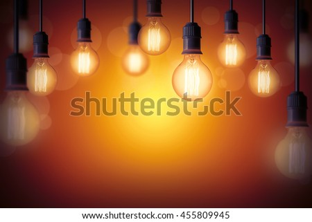 Idea concept background with light bulb in warm gradient background - stock photo