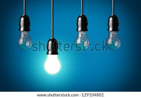 Idea concept.Blue background. - stock photo