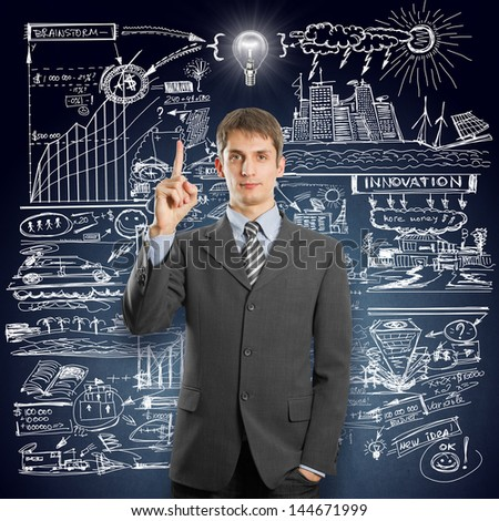 Idea concept. Businessman in suit, looking on camera, with lamp above his head - stock photo
