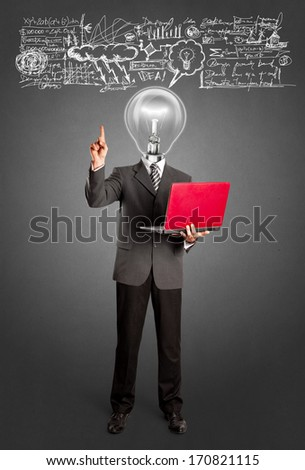 Idea concept. Lamp head business man shows something with his finger