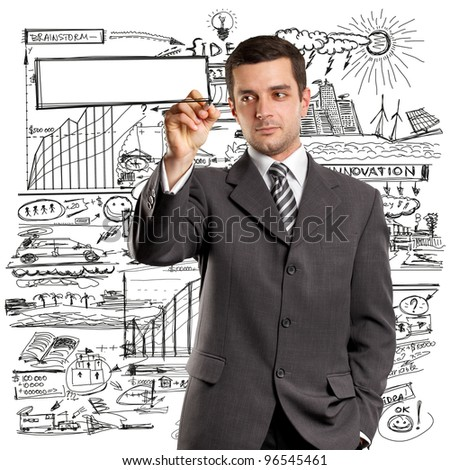 Idea concept, man businessman writing something on glass board with marker - stock photo