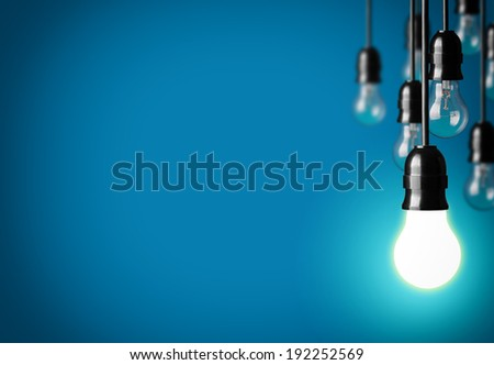 Idea concept on blue background.  - stock photo