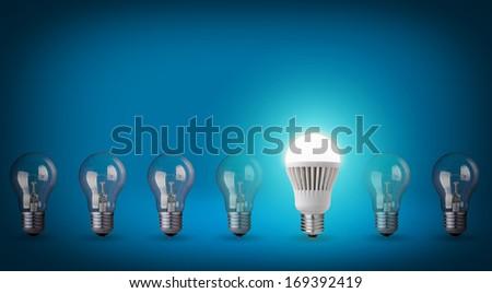 Idea concept on blue background. Row with light bulbs and LED bulb.  - stock photo
