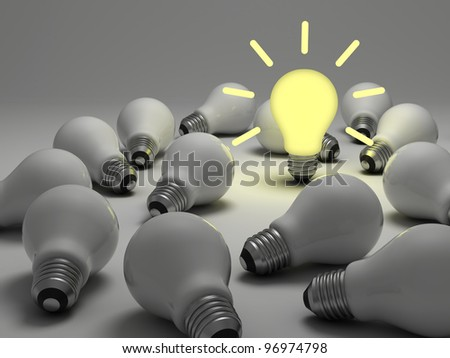 Idea concept, One glowing light bulb standing out from the unlit incandescent bulbs on white background - stock photo
