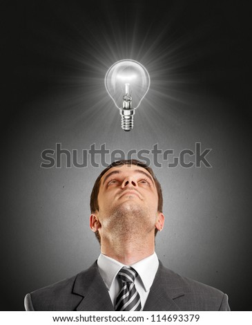idea concept with businessman looking upwards, with lamp