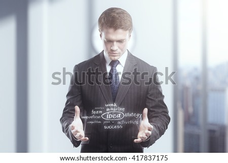 Idea concept with businessman on blurry office background - stock photo