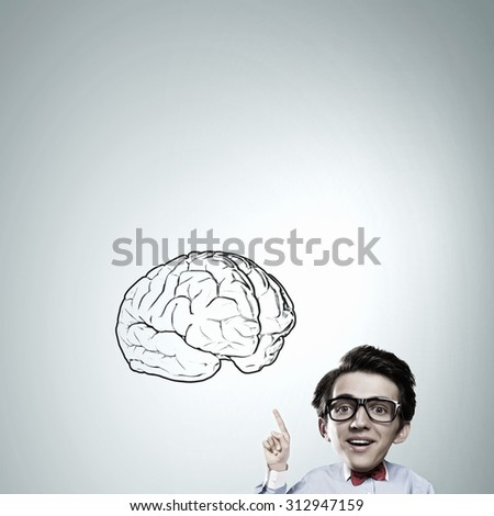 Idea concept with businessman with big head pointing at big  brain - stock photo