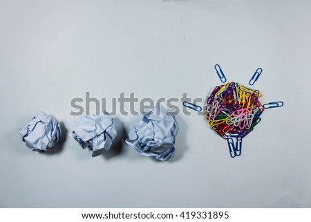 idea concept with crumpled  paper and light bulb on white background. - stock photo