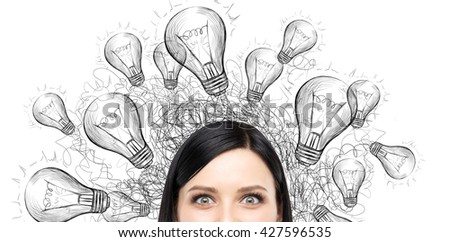 Idea concept with light bulb drawings around smizing woman on white background - stock photo