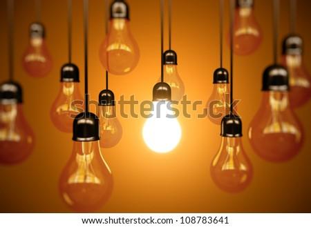 idea concept with light bulbs on a orange background - stock photo
