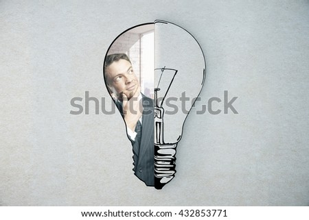 Idea concept with lightbulb sketch and thoughtful businessman - stock photo