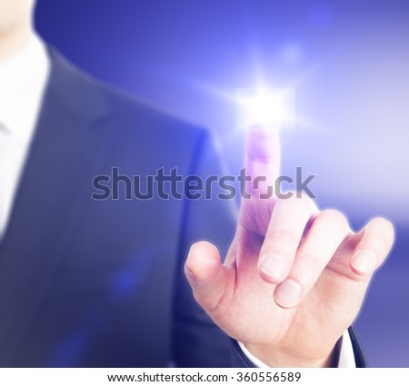 Idea concept with man finger touches digital screen  - stock photo