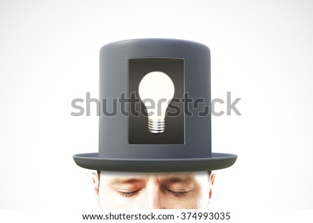 Idea concept with man head in black cylinder with white light bulb in the center - stock photo