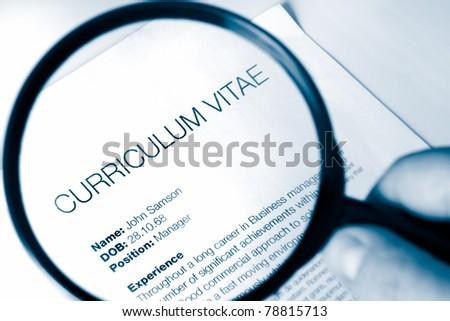 idea for examining a cv for a job application - stock photo