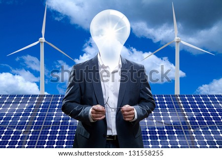 Idea man in front of a solar panel.
