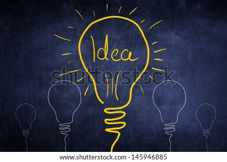 Idea sketch concept with light bulb sign