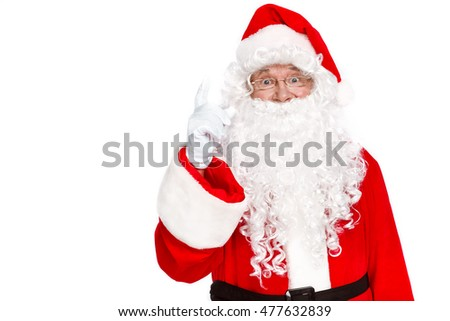 Idea! Traditional Santa Claus pointing up while standing against on white background