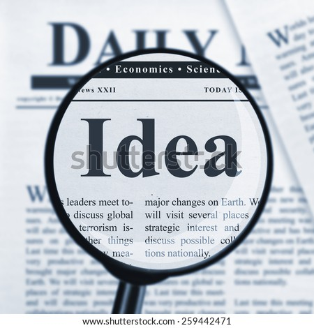 Idea under magnifying glass - stock photo