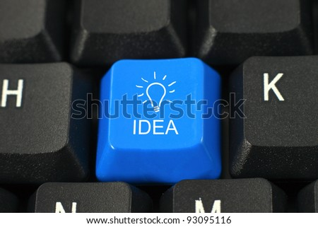 Idea word on blue and black keyboard button - stock photo
