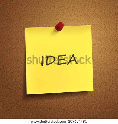 idea word on post-it over brown background - stock photo