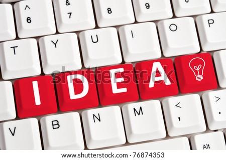 Idea word on white keyboard - stock photo