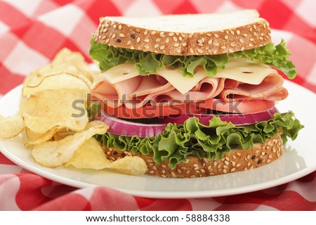Ideal, perfectly stuffed sandwich with ham and Swiss cheese - stock photo