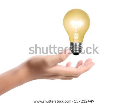 Ideas bulb light on a hand  - stock photo