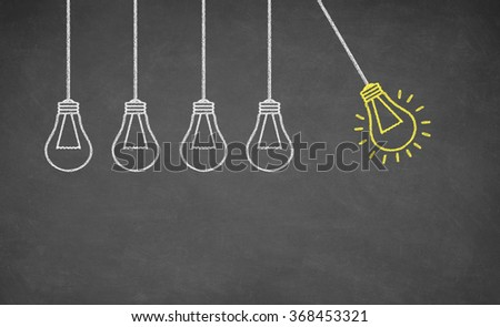 Ideas Light Bulb Concept Work on Blackboard