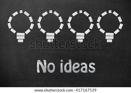 Ideas Light Bulb Concept Work on Blackboard. Bulbs set figures of the children's designer and motivational text - stock photo