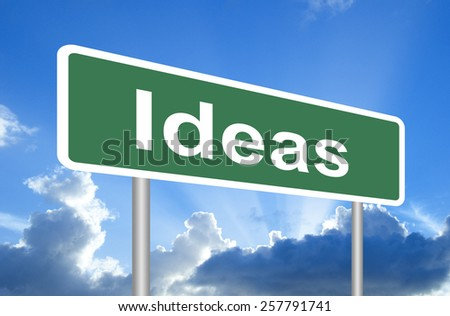 Ideas road sign on blue sky with clouds and clipping path - stock photo