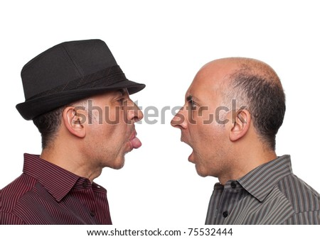 Identical twins fighting - stock photo