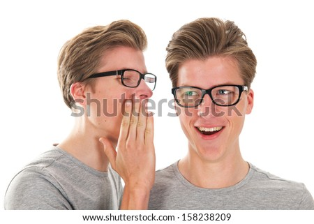 Identically adult male twins whispering in ear isolated over white background - stock photo