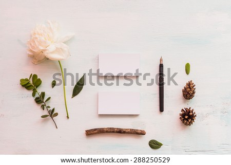 Identity and craft mockup set with retro filter effect. Cute vintage mock up on wooden background. Selective focus photo with shallow DOF. - stock photo