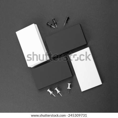 identity design, corporate templates, company style, black and white business cards on a black background - stock photo