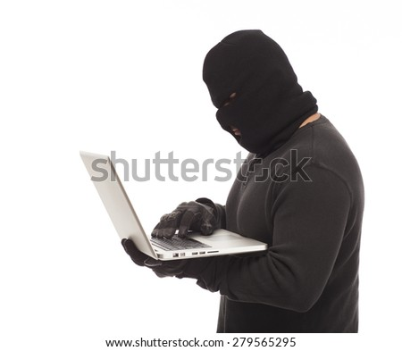 Identity thief with laptop computer on white background. - stock photo