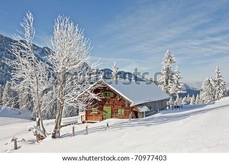 Idyllic alpine hut in winter in Isarwinkel - stock photo