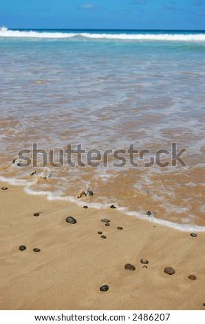 Idyllic Australian beach with pebbles - stock photo