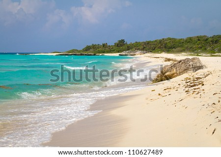 Idyllic beach of Caribbean Sea in Playacar, Mexico - stock photo