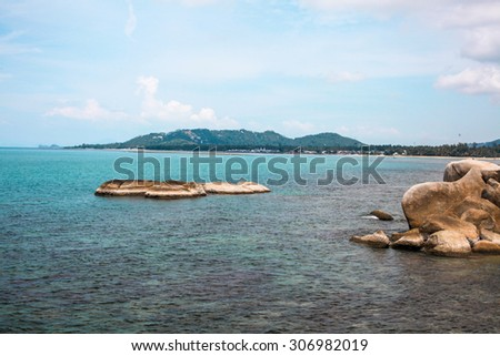 Idyllic blue sea and clear sky and stand-alone small island.Taken in Koh Samui, Thailand - stock photo