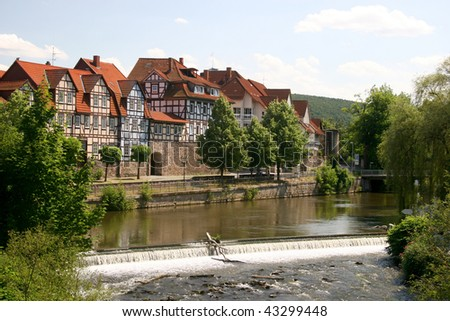 Idyllic city Hann Münden in Germany and river Fulda, famous for his beautiful half-timbered architecture - stock photo