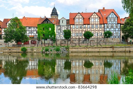 Idyllic city Hann Munden in Germany and river Fulda, famous for his beautiful half-timbered architecture - stock photo