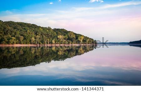 Idyllic crystal clear, mirror reflecting lake in Wisconsin - stock photo