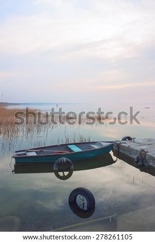 Idyllic landscape with boat on Lake Balaton - stock photo